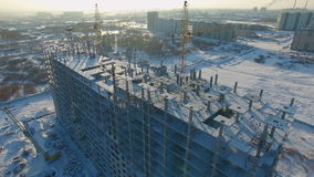 Winter view of a building under construction. stock footage