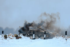Winter view of the burning german tank panzer in the battle. Royalty Free Stock Photos
