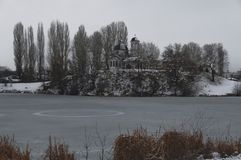 Winter view of Christian church and small dam Stock Photo