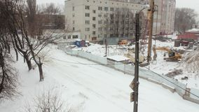 Winter view of the construction site, the falling snow stock video footage