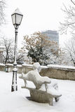 A winter view of the famous statue of the croatian writer Antun. Gustav Matos overseeing the skyscraper on the main square Stock Photos