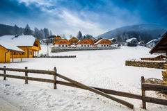 Winter view of farm on mountain at Austrian town Stock Photos
