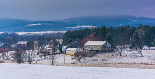 Winter view of a farm and the Piegon Hills, near Spring Grove, P. Ennsylvania Stock Image