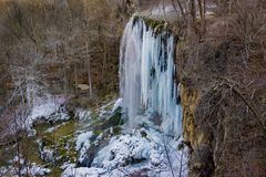 A Winter View of the frozen Falling Spring Falls. A winter view of the 80 foot frozen Falling Spring Falls located in the Allegheny Mountain, Virginia, USA Stock Image