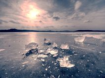 Winter view of the frozen  sea to the opposite bank.  The sun glare  in ice. Winter view of the frozen  sea to the opposite bank.  The sun in ice colorful glare Stock Photos