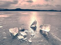 Winter view of the frozen  sea to the opposite bank.  The sun glare  in ice. Winter view of the frozen  sea to the opposite bank.  The sun in ice colorful glare Stock Image