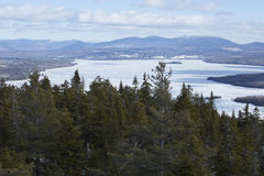 Winter view of an ice covered Cupsuptic Lake, Rangeley, Maine. Stock Photos