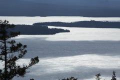 Winter view of an ice covered Mooselookmeguntic Lake, Rangeley, Stock Image