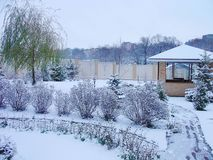 Winter view landscape design in a private yard. Cosy barbeque house / grill house. Beautiful exterior stock photo