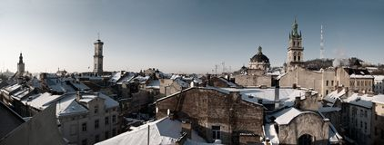 Winter view of Lviv, Ukraine central part in black and white. Rooftops covered with snow in the center of Lviv, Ukraine royalty free stock photography