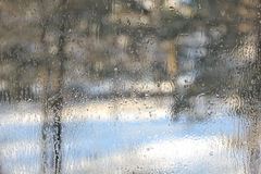 Winter view through misted over glass. Royalty Free Stock Images