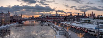 Winter view of Moscow Kremlin and Moscow river. Panoramic view of Moscow Kremlin and Moscow river with street illumination at sunset royalty free stock photography