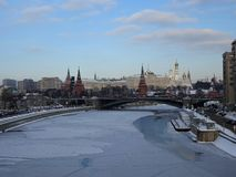 Winter, View of the Moscow River, a stone bridge, towers of the Kremlin, the cathedral. royalty free stock images