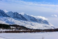 Winter view of the mountain range seven sisters in Alstadhaug, N stock image