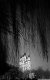Winter view of Orthodox church through branches. Royalty Free Stock Images