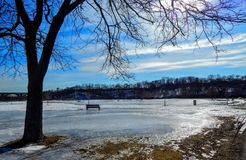 Winter View By The Park Bench. Cold And Icy Day In Winter By A Park Bench Overlooking The Raritan River In New Jersey Royalty Free Stock Photos