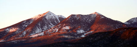 A Winter View of the Peaks at Sunset Stock Photo