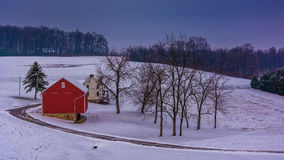 Winter view of a red barn on a farm in rural York County, Pennsy Royalty Free Stock Photography