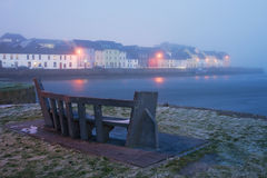 Winter view on the river and houses in fog Royalty Free Stock Photography