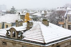Winter view of roofs and chimneys covered with heavy snow. Winter landscape. Snowfall in Burgas, Bulgaria.  stock photography
