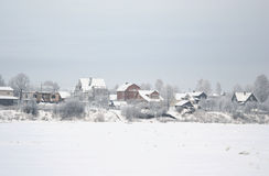 Winter view of russian village. Royalty Free Stock Images