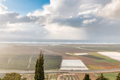 Winter view of the sea and fields Stock Photography