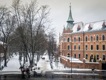 Winter view of Seminary, Planty park and carriage in Krakow, Pol Royalty Free Stock Images