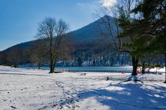 Winter View of Sharp Top Mountain. The first snowfall at the Peaks of Otter with Sharp Top Mountain in the background and Abbott Lake in the foreground located Stock Photo