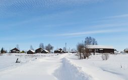Winter view of small russian village. View of snowy russian village at winter day Stock Photography