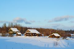 Winter view of small russian village. View of snowy russian village at winter day Royalty Free Stock Photos