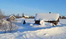 Winter view of small russian village. View of snowy russian village at winter day Stock Photo