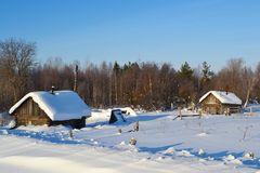 Winter view of small russian village. View of snowy russian village at winter day Royalty Free Stock Photo