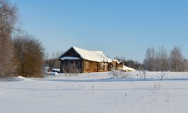 Winter view of small russian village. View of snowy russian village at winter day Royalty Free Stock Images
