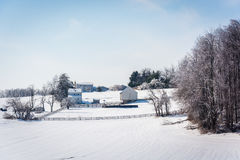 Winter view of a snow-covered farm in rural Carroll County, Mary. Land Stock Photo
