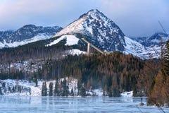 Strbske pleso lake in High Tatras in Slavakia. Winter view on Strbske pleso with ski jump ramp in High Tatras royalty free stock photography