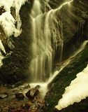 Winter view to cascade of waterfall Royalty Free Stock Photography