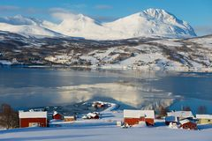 Winter view to Lavangen fjord and Soloy village, Troms county, Norway. stock image