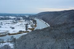 Aidar River in Ukraine. Winter. View from the top of the snow-covered forest, frozen river and valley. Aidar River in Ukraine. Lugansk region stock photo