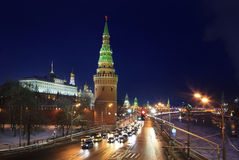 Winter view of Vodovzvodnaya tower of Moscow Kreml. In and Kremlin Embankment at night, Russia stock photography