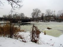 Winter view of the Vorskla River from the city bridge stock photography