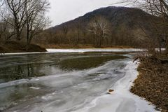 Winter View on the Craig Creek and James River. A winter view on the where Craig Creek joints the James River located with Crawford Mountain in the background Royalty Free Stock Photography