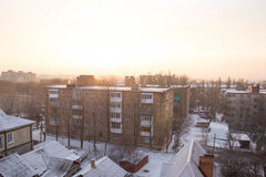 Winter view from the window with houses Royalty Free Stock Photo