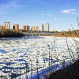 Winter views of Edmonton along the north Saskatchewan river. With ice chunks floating along the river stock photography