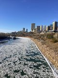 Winter views of Edmonton along the north Saskatchewan river. With ice chunks floating along the river stock images