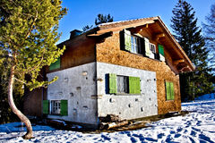 Winter villa. Typical wooden villa in winter snowy forest Stock Photography