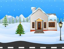 Winter village background with snow covered house and mountains Stock Photography