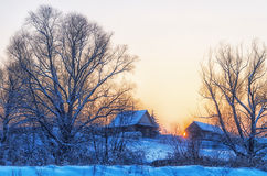 Winter. Village. Evening. Cold sunset in winter village Stock Photos