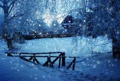 Winter village, evening Stock Photos