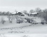 Winter village. Farms in a winter field Royalty Free Stock Photography