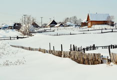 Winter in the village. The frosty winter came to the villages of Altai Stock Image